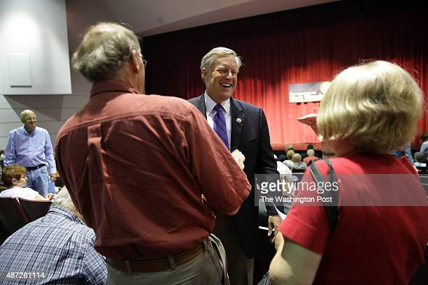 Congressman Mark Meadows , center, greets constituents before leading a Town Hall meeting at Blue Ridge Community College in Flat Rock, NC on Friday,...