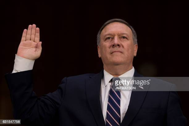 US Congressman Mike Pompeo RKansas is sworn in before testifying before the Senate Intelligence Committee on Capitol Hill in Washington DC January 12...