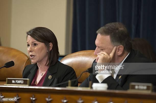 Congressman Mike Pompeo RKansas listens as Congresswoman Martha Roby RAlabama questions Former Secretary of State and Democratic Presidential hopeful...