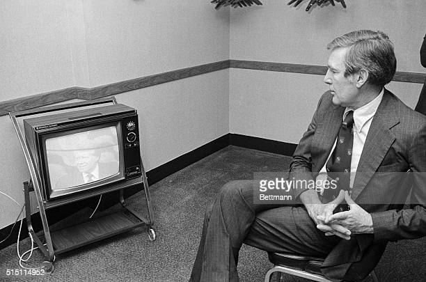 Congressman Morris Udall watches Governor Jimmy Carter on television as he watched the election returns here 5/25 Udall failed to win any of...