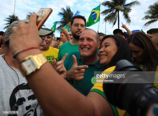 Congressman Onyx Lorenzoni and supporters of farright lawmaker and presidential candidate for the Social Liberal Party Jair Bolsonaro take part in a...