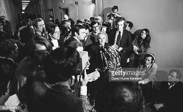 Congressman Peter Rodino chair of the House Judicial Committee that oversaw the Richard Nixon impeachment hearings surrounding by journalists...