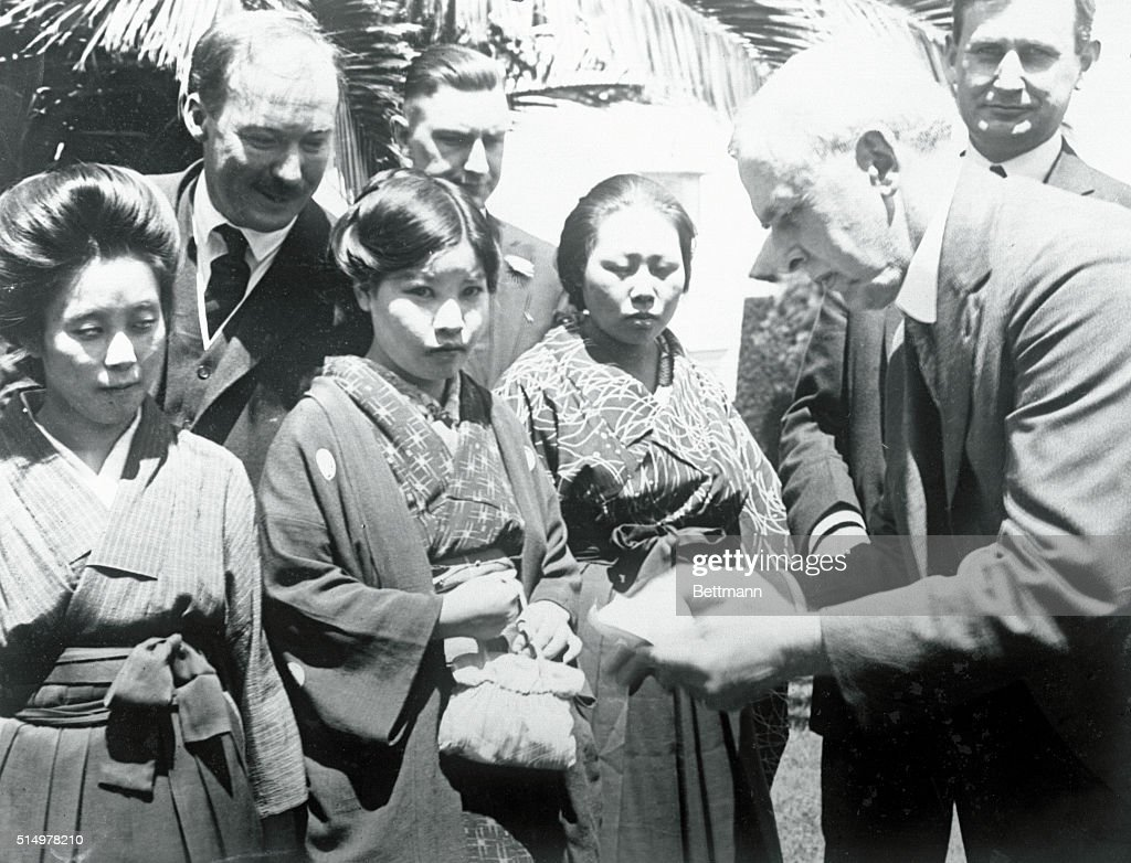 Officials Looking over Passports of Japanese Brides : News Photo