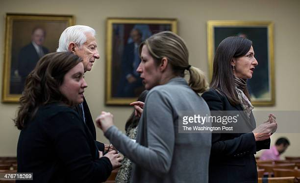 WASHINGTON DC DECEMBER Congressman Ralph Hall approaches Sara Seager professor of physics and planetary science at the Massachusetts Institute of...