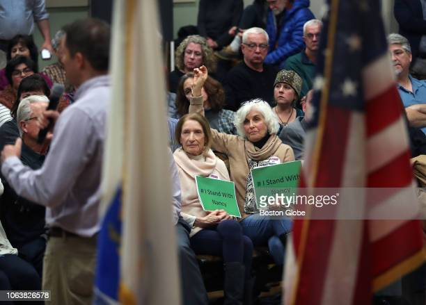 Congressman Seth Moulton with back to camera at far left hosts a Town Hall meeting at Amesbury City Hall in Amesbury MA on Nov 19 2018 Some attendees...