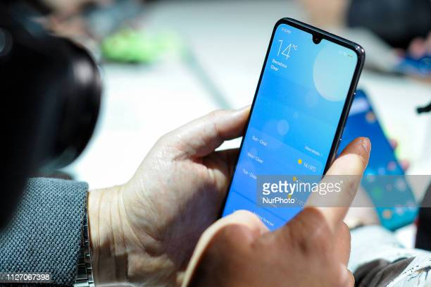 Congressman testing the new Xiaomi Mi9 at Xiaomi launch, during the Mobile World Congress, on February 24, 2019 in Barcelona, Spain.