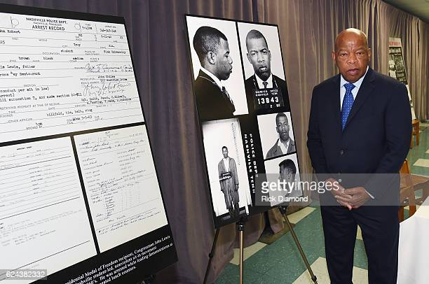 Congressman/Civil Rights Icon John Lewis poses by images and his arrest record for leading a nonviolent sitin at Nashville's segreated lunch counters...
