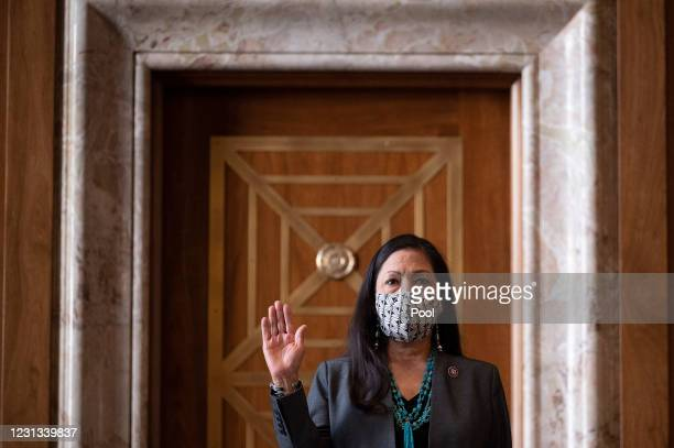 Congresswoman Deb Haaland, , is sworn in during the Senate Committee on Energy and Natural Resources hearing on her nomination to be Interior...