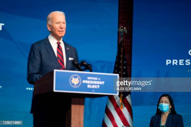 Congresswoman Deb Haaland listens as US President-elect Joe Biden speaks during an event to introduce key Cabinet nominees and members of his climate...