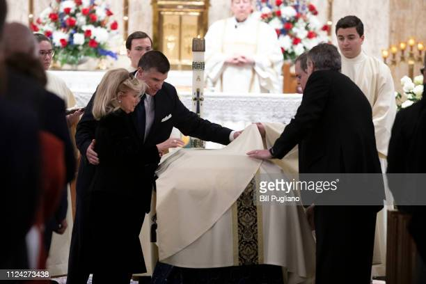 Congresswoman Debbie Dingell and her son Christopher put the pall on the casket of her husband, former congressman John Dingell, at his funeral at...