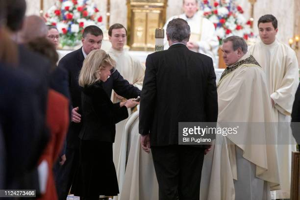 Congresswoman Debbie Dingell and her son Christopher put the pall on the casket of her husband former congressman John Dingell at his funeral at the...