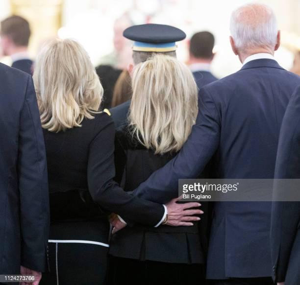 Congresswoman Debbie Dingell arrives with former Vice President Joe Biden and his wife Jill Biden for the funeral of her husband former congressman...