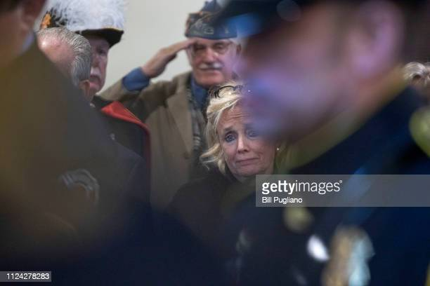 Congresswoman Debbie Dingell watches as an American flag is placed on the casket of her husband former congressman John Dingell at his funeral at the...