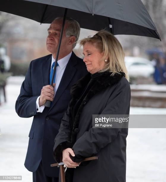 Congresswoman Debbie Dingell watches as the casket of her husband former congressman John Dingell is placed into the hearse at his funeral at the...