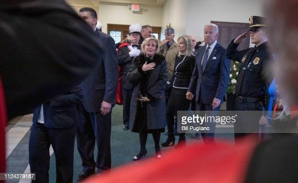 Congresswoman Debbie Dingell watches with former Vice President Joe Biden as an American flag is placed on the casket of her husband former...