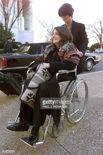 Congresswoman Diana DeGette is wheeled from her car to the House of Representatives early 18 December after leaving a Colorado hospital where she was...