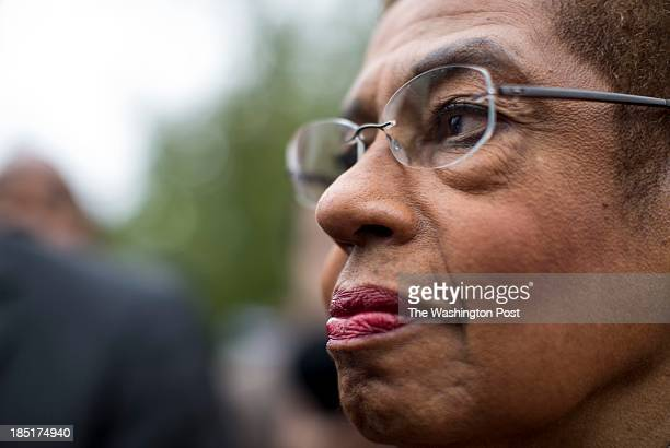 Congresswoman Eleanor Holmes Norton stands by Mayor Vincent Gray in front the US Capitol building after a press concerning the effects of the...