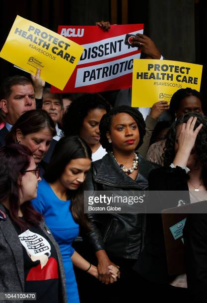 Congresswoman elect Ayanna Pressley held onto Alexandria OcasioCortez's hand at a rally held to call on Senator Jeff Flake to reject Judge Brett...