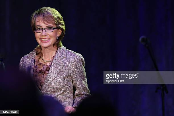"Congresswoman Gabrielle Giffords receives the 2012 Salute to Women award from Intrepid Sea, Air and Space Museum at the museum's 21st annual ""Salute..."