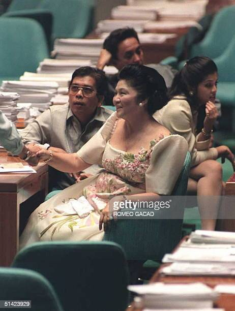Congresswoman Imelda Marcos exchanges pleasantries with her colleagues in the House of Representatives during her first day in office 06 November The...