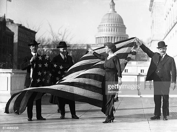 Congresswoman Jeannette Rankin is presented with the flag that flew at the House of Representatives during the passage of the suffrage amendment.