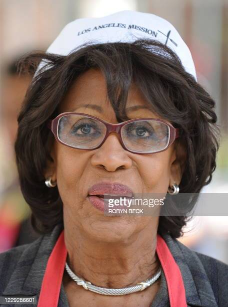 Congresswoman Maxine Waters volunteers at the Los Angeles Mission to help serve the free Easter dinner to the needy and homeless, in downtown Los...