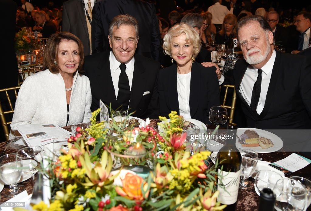 Congresswoman Nancy Pelosi, businessman Paul Pelosi, actress Helen Mirren, and director Taylor Hackford attend MusiCares Person of the Year honoring Tom Petty at the Los Angeles Convention Center on February 10, 2017 in Los Angeles, California.