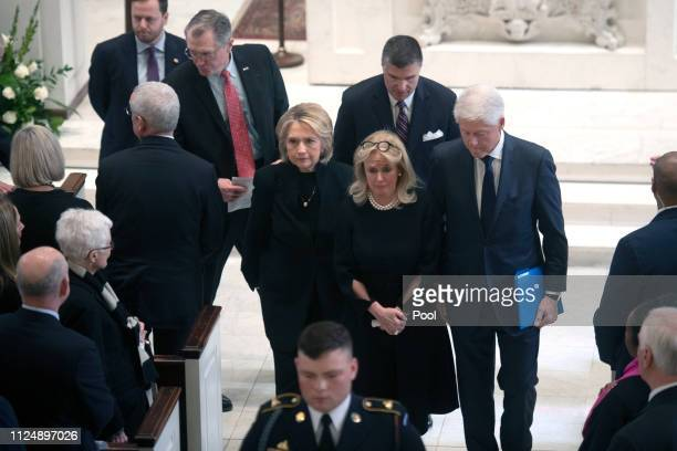 Congresswoman Rep. Debbie Dingell is flanked by former Secretary of State Hillary Clinton and former President Bill Clinton at the conclusion of the...
