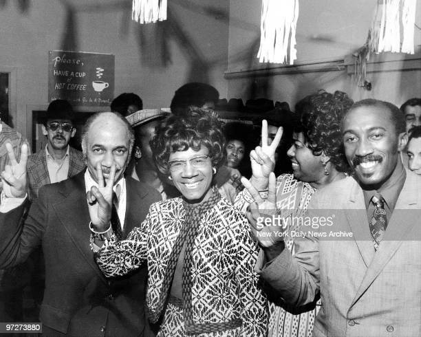 Congresswoman Shirley Chisholm flashes victory sign at her campaign headquarters at 1467 Bedford Avenue Brooklyn