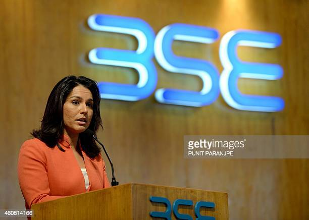 US Congresswoman Tulsi Gabbard speaks during her visit to the Bombay Stock Exchange in Mumbai on December 24 2014 Gabbard is in India on an eightday...