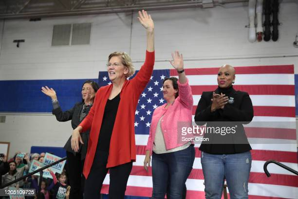 Congresswomen Deb Haaland Katie Porter and Ayanna Pressley join Democratic presidential candidate Sen Elizabeth Warren for a rally at Rundlett Middle...