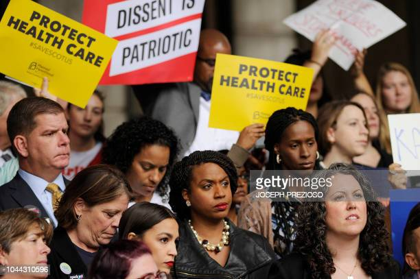 Congresswomenelect Ayanna Pressley stands with New York Democratic congressional candidate Alexandria OcasioCortez during a rally of sexual assault...