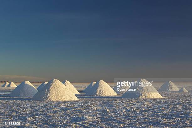 Conical heaps of excavated salt near Colchani, Salar de Uyuni, Bolivia, South America