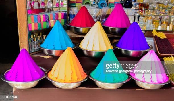 Conical piles of colored powders, Kochi, Kerala, India