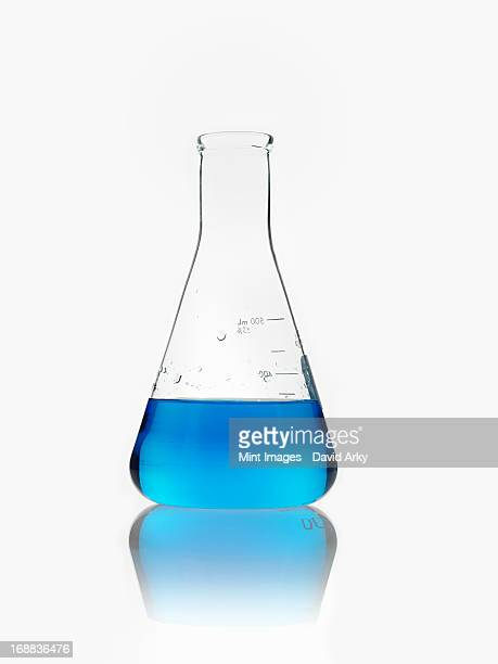 A conical scientific glassware flask partly filled with blue liquid.