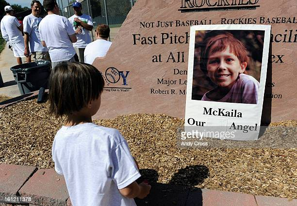 DENVER CONicholas Espinola 8yearsold looks at a large picture of McKaila J Steffes that greets kickballers at the 3rd annual McKaila Ball a kickball...
