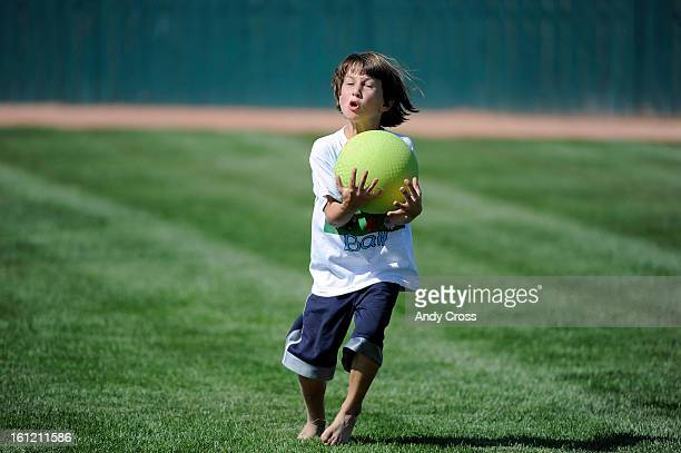 DENVER CONicholas Espinola 8yearsold makes a great catch for an out during the 3rd annual McKaila Ball a kickball party at the Colorado Rockies Fast...
