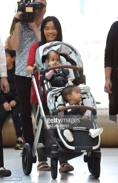 Conjoined Bhutanese twins fifteenmonthold Nima and Dawa and their mother Bhumchu Zangmo leave the Royal Children's Hospital in Melbourne on November...