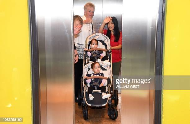 TOPSHOT Conjoined Bhutanese twins fifteenmonthold Nima and Dawa and their mother Bhumchu Zangmo leave the Royal Children's Hospital in Melbourne on...