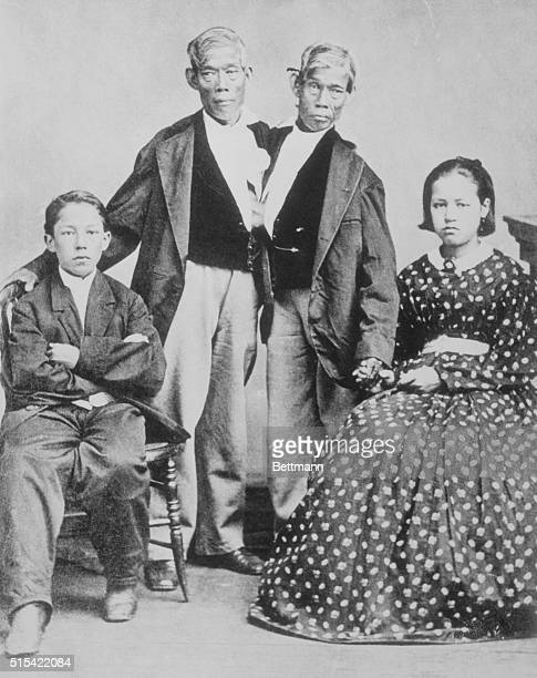 Conjoined twins Chang and Eng Bunker born in 1829 in Siam of Chinese parents with two of their children