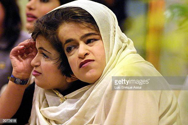 Conjoined twins Ladan and Laleh Bijani speak during a news conference at Raffles Hospital June 11 2003 in Singapore The Iranian sisters arrived in...