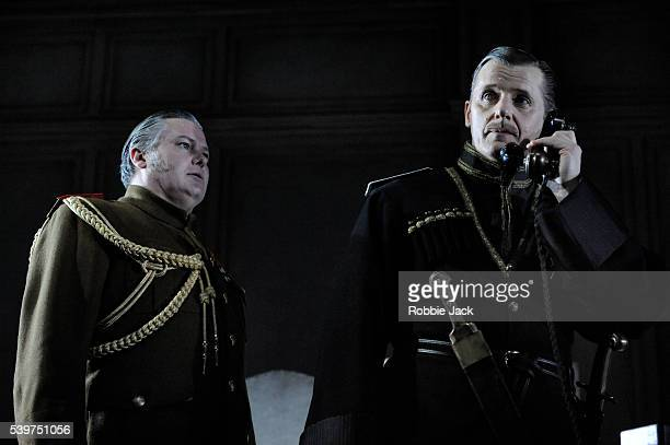 Conleth Hill as Leonid and Anthony Calf as The Hetman in the production of Mikhail Bulgakov's 'The White Guard' directed by Howard Davies at the...
