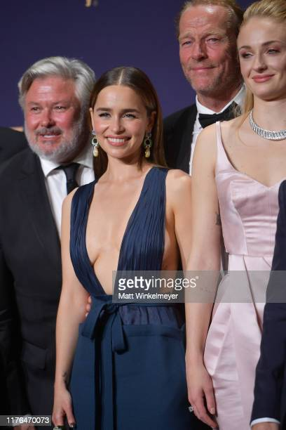Conleth Hill, Emilia Clarke, Iain Glen, and Sophie Turner pose in the press room during the 71st Emmy Awards at Microsoft Theater on September 22,...