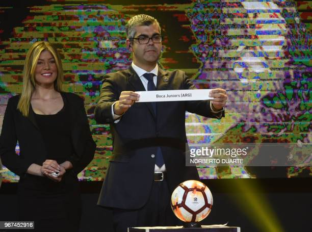Conmebol Competitions' director Frederico Nantes shows the name of Argentina's Boca Juniors during the 2018 Copa Libertadores round of 16 draw in...