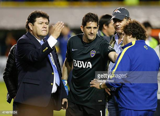 Conmebol delegate Roger Bello of Bolivia Agustin Orion goalkeeper of Boca Juniors and Alejandro Burzaco president of Torneos talk moments before the...