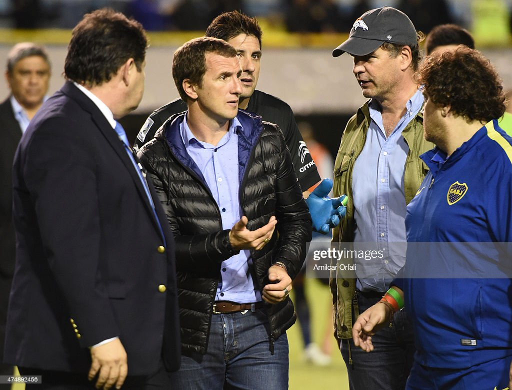 Conmebol delegate Roger Bello of Bolivia (L), Rodolfo Arruabarrena head coach of Boca Juniors (second from left), Agustin Orion goalkeeper of Boca Juniors (back) and Alejandro Burzaco President of Torneos (cap) talk moments before the suspension of the Copa Bridgestone Libertadores match between Boca Juniors and River Plate at Alberto J. Armando Stadium on May 14, 2015 in Buenos Aires, Argentina. On May 27, 2015 a United States Justice Department accused nine FIFA officials and five corporate executives of racketeering, wire fraud and money laundering conspiracy. Burzaco has a position in the FIFA Sports Marketing department and is one of the three Argentines accused of paying 150 million dollars in bribes in exchange for mass media and commercialisation rights for international tournaments.