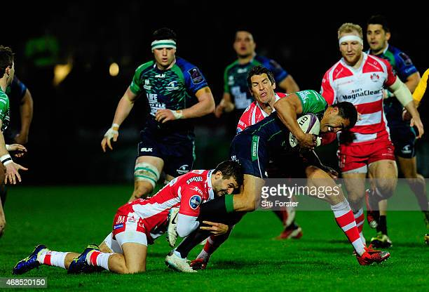Connacht full back Mils Muliaina is stopped by Jonny May and James Hook of Gloucester during the European Rugby Challenge Cup Quarter Final match...