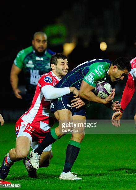 Connacht full back Mils Muliaina is stopped by Jonny May of Gloucester during the European Rugby Challenge Cup Quarter Final match between Gloucester...