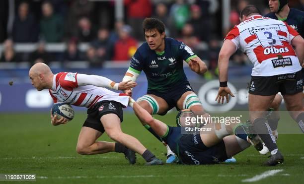 Connacht player Joe Maksymiw gets hold of Gloucester scrum half Joe Simpson during the Heineken Champions Cup Round 3 match between Gloucester Rugby...