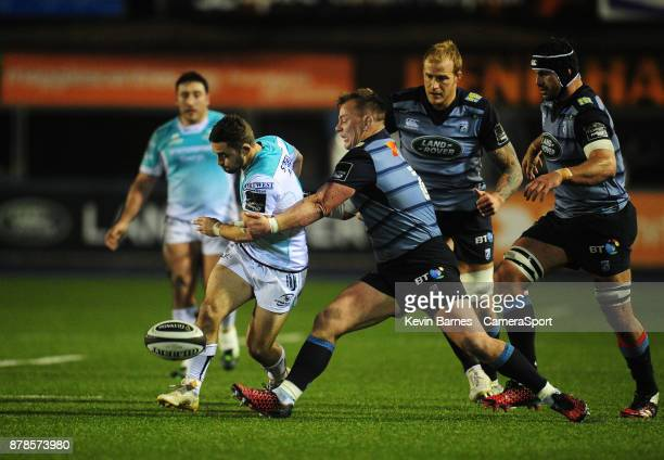 Connacht's Caolin Blade kicks through despite the attentions of Cardiff Blues' Matthew Rees during the Guinness Pro14 Round 9 match between Cardiff...